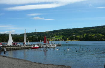 Enjoy boating, cycling or walking by Coniston Water in the Lake District National Park