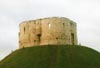Visit Clifford's Tower near York's city walls, surrounded by geese