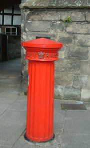 Post box in the shape of a Doric pillar