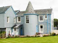 comfortable 4 star apartments in turreted building near Loch Lomond Scotland.  Each apartment sleeps 2-4 people.