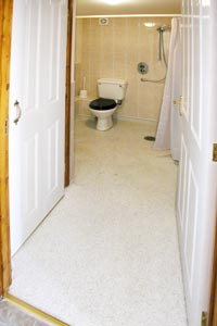 Cottages and self-catering holidays for the disabled.  The picture shown is of a bathroom with wide access and an open shower for wheelchairs at Walkers Farm Cottages in Devon