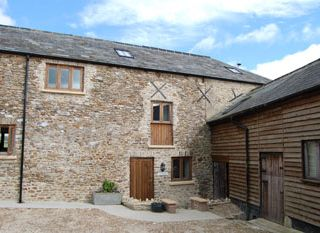 Barn conversion in Devon with 3 stables available